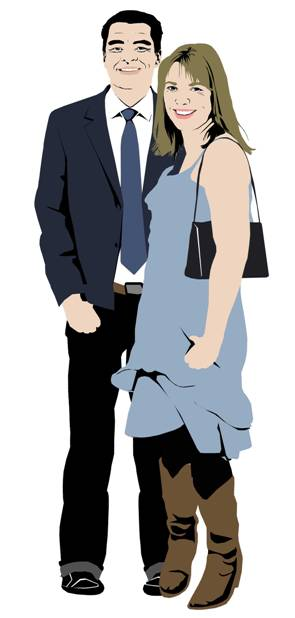 Male parent in suit shirt and tie with female parent in blue dress