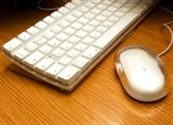 A white computer keyboard and mouse